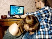 Boyfriend playing games is surprised with a blowjob from girlfriend